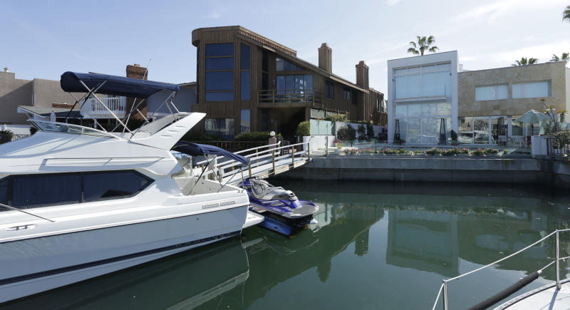 A boat and jet ski sit tied to a private dock behind the home, right, owned by the family of Mexican union leader Elba Esther Gordillo in Coronado, Califonia, Wednesday, Feb. 27, 2013. Gordillo was arrested and accused Tuesday in Mexico of embezzling $160 million in union funds to pay for everything from California homes and plastic surgery procedures to her Neiman Marcus bill. The arrest of Mexico's most powerful union leader echoes the hardball tactics of Mexico's once-imperial presidency while pushing forward an education reform that President Enrique Pena Nieto has made a centerpiece of his new administration. (AP Photo/Gregory Bull)