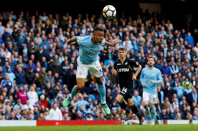 "Soccer Football - Premier League - Manchester City v Swansea City - Etihad Stadium, Manchester, Britain - April 22, 2018 Manchester City's Gabriel Jesus scores their fifth goal REUTERS/Phil Noble EDITORIAL USE ONLY. No use with unauthorized audio, video, data, fixture lists, club/league logos or ""live"" services. Online in-match use limited to 75 images, no video emulation. No use in betting, games or single club/league/player publications. Please contact your account representative for further details. TPX IMAGES OF THE DAY"