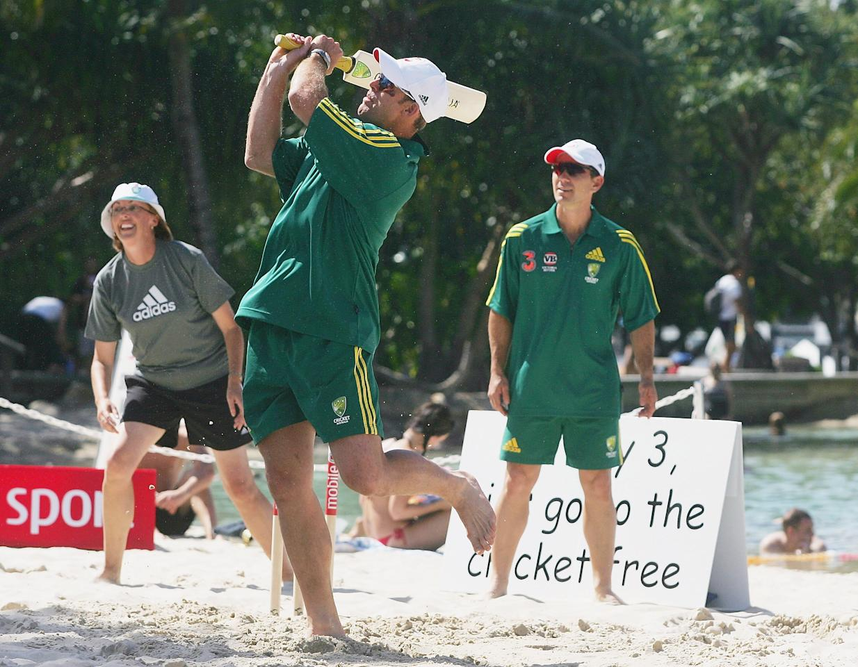 BRISBANE, QSL - OCTOBER 31:  (L-R) Matthew Hayden and Justin Langer of Australia play beach cricket during the 2005/2006 International Season Launch held at the Streets Beach at Southbank on October 31, 2005 in Brisbane, Australia.  (Photo by Hamish Blair/Getty Images)
