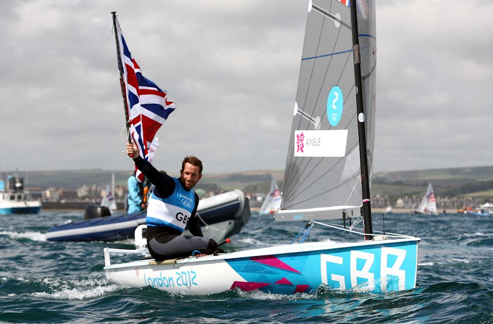 Great Britain's Ben Ainslie celebrates winning the Gold Medal after the Men's Finn Medal Race in Weymouth, during day nine of the London 2012 Olympics.