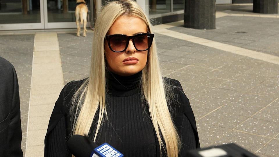 McKenzie Robinson is seen here outside Brisbane Magistrates Court on Thursday.