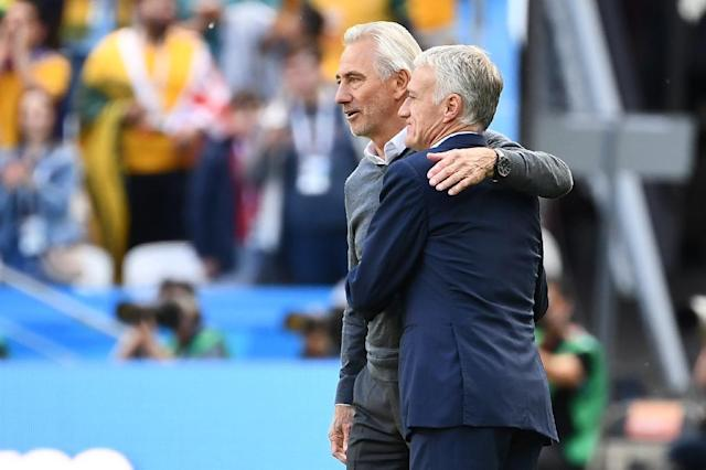 Australia coach Bert van Marwijk congratulates his French opposite number Didier Deschamps (AFP Photo/FRANCK FIFE)