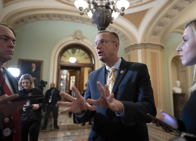 Rep. Doug Collins, R-Georgia, the ranking member of the House Judiciary Committee, speaks to reporters outside the Senate as defense arguments by the Republicans resume in the impeachment trial of President Donald Trump on charges of abuse of power and obstruction of Congress, at the Capitol in Washington, Monday, Jan. 27, 2020. (AP Photo/J. Scott Applewhite)