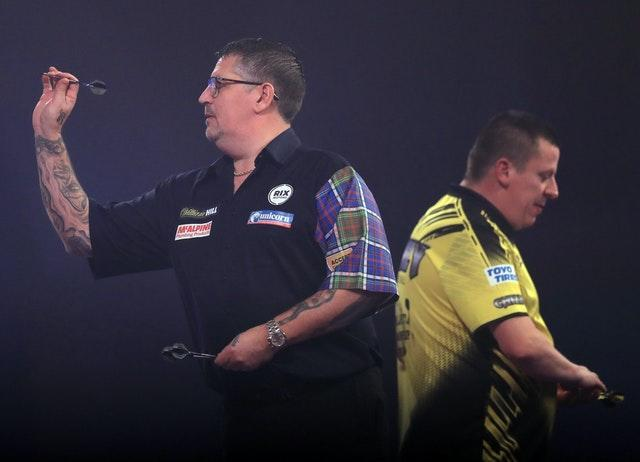 Gary Anderson, left, secured a 6-3 win over Dave Chisnall in Saturday night's semi-final (Adam Davy/PA)