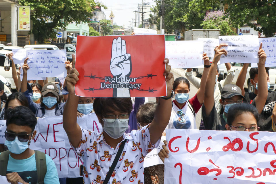 Anti-coup protesters march on the street during a demonstration in Yangon, Myanmar, on Friday, April 23, 2021. Leaders of the 10-member Association of Southeast Asian Nations meet Saturday, April 24, in Jakarta to consider plans to promote a peaceful resolution of the conflict that has wracked Myanmar since its military launched a deadly crackdown on opponents to its seizure of power in February. (AP Photo)