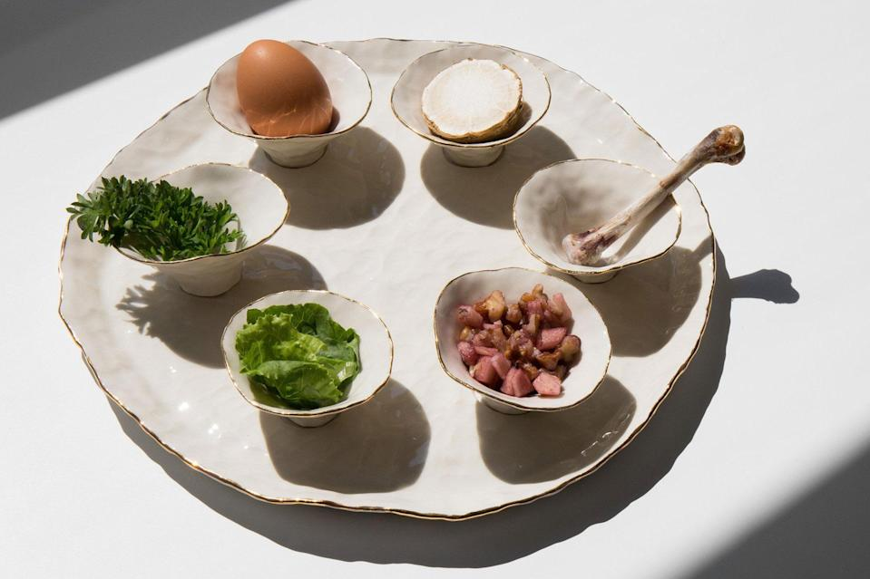 """<p>In this delicate set, each Seder plate has six pinch pots to hold the six symbolic foods used in the ritual meal. All six pinch pots are clear glazed and lined with 22 karat gold.</p> <p><em><strong>Shop Now:</strong> Isabel Halley Ceramics The Seder Plate, $390, <a href=""""https://www.isabelhalley.com/imported-products/the-seder-plate"""" rel=""""nofollow noopener"""" target=""""_blank"""" data-ylk=""""slk:isabelhalley.com"""" class=""""link rapid-noclick-resp"""">isabelhalley.com</a>.</em></p>"""