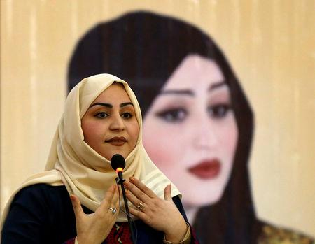 Female Afghan parliamentary election candidate, Suhaila Sahar, speaks among her supporters during an election campaign in Kabul, Afghanistan October 8, 2018. REUTERS/Omar Sobhani