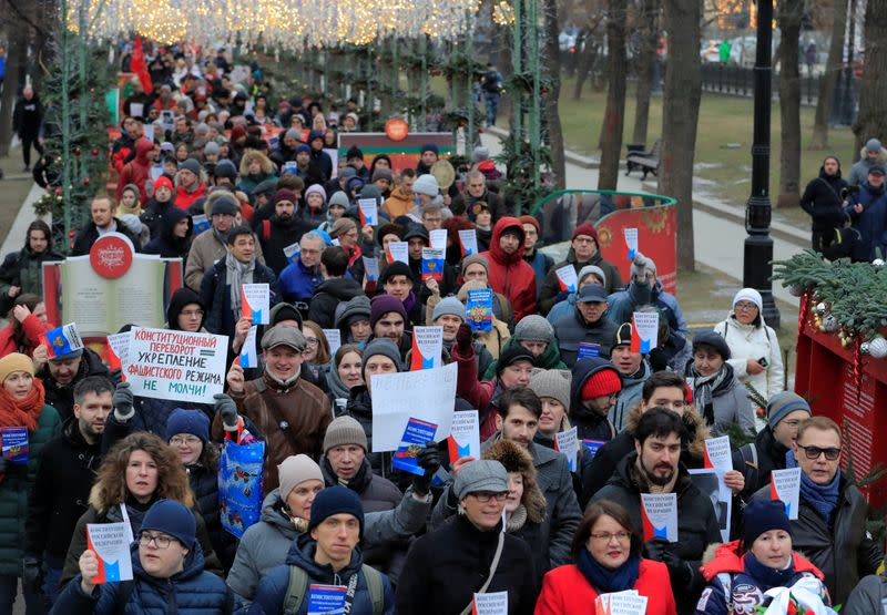 Opposition supporters hold a copies of Russia's constitution during a rally against constitutional reforms proposed by President Vladimir Putin, in Moscow