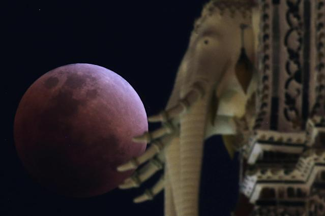 "<p>A ""super blood blue moon"" is seen during an eclipse behind an elephant statue at a temple in Bangkok, Thailand, Jan. 31, 2018. (Photo: Athit Perawongmetha/Reuters) </p>"