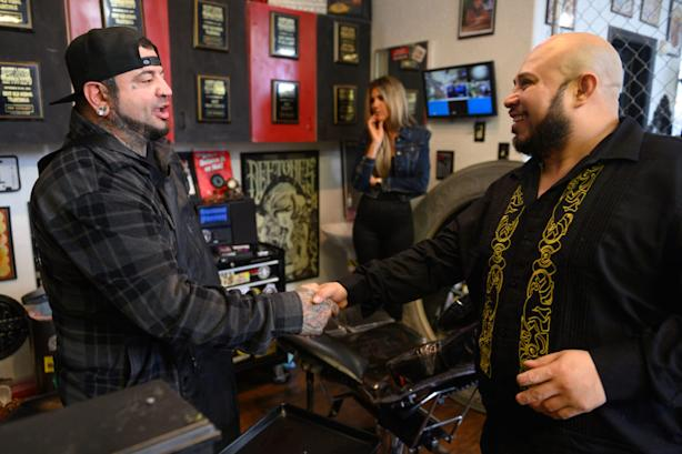 José Alvarado shakes hands with Eric Catalano after the fingernail tattoo procedure at Eternal Ink Tattoo Studio on Nov. 20, 2019, in Hecker, Ill. (Michael B. Thomas for KHN)
