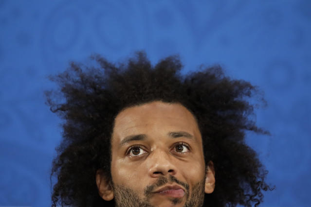 Brazil's Marcelo listen to questions during a press conference after Brazil's official training on the eve of the group E match between Brazil and Switzerland at the 2018 soccer World Cup in the Rostov Arena in Rostov-on-Don, Russia, Saturday, June 16, 2018. (AP Photo/Felipe Dana)