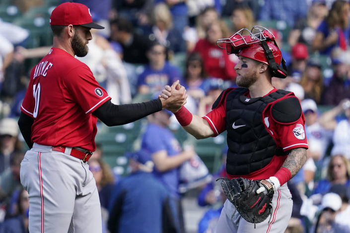 Cincinnati Reds relief pitcher Tejay Antone, left, celebrates with catcher Tucker Barnhart after they defeated the Chicago Cubs in a baseball game in Chicago, Sunday, May 30, 2021. (AP Photo/Nam Y. Huh)