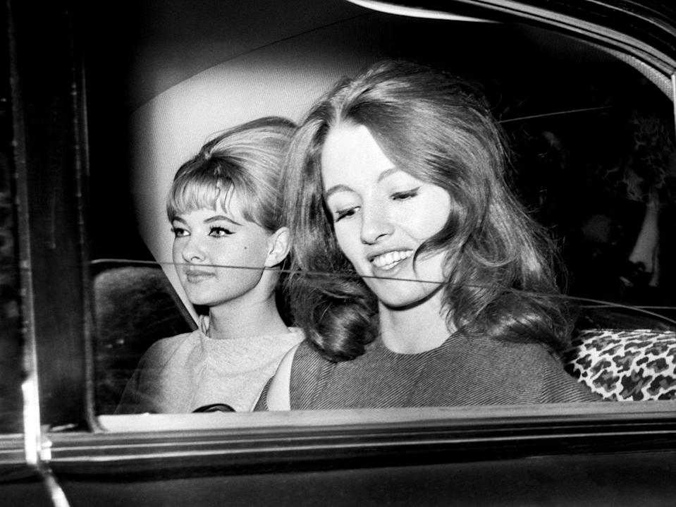 Keeler, along with her flatmate Mandy Rice-Davies (left), was subjected to huge press attention in 1963PA