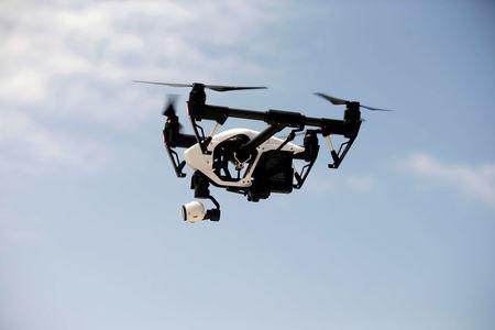 FILE PHOTO: A DJI Inspire drone hovers during a drone training session for Somali police in Mogadishu
