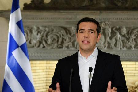 Greek PM Tsipras addresses the nation from his office in Maximos Mansion in Athens