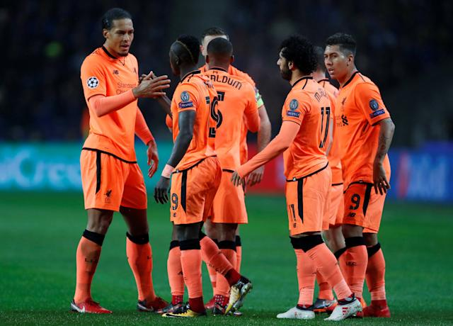 Soccer Football - Champions League Round of 16 First Leg - FC Porto vs Liverpool - Estadio do Dragao, Porto, Portugal - February 14, 2018 Liverpool's Sadio Mane celebrates scoring their first goal with Virgil van Dijk, Mohamed Salah and team mates Action Images via Reuters/Matthew Childs