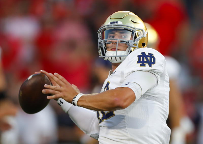 ATHENS, GA - SEPTEMBER 21: Notre Dame Fighting Irish quarterback Ian Book (12) warms up prior to the Notre Dame Fighting Irish v Georgia Bulldogs game on September 21, 2019 at Sanford Stadium in Athens, GA.(Photo by Todd Kirkland/Icon Sportswire via Getty Images)