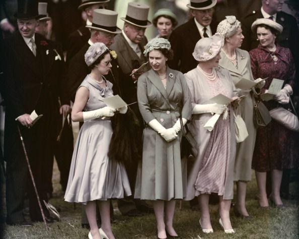 <p>Princess Margaret, Queen Elizabeth II, and the Queen Mother visit the Epsom Downs Racecourse for the Derby.</p>