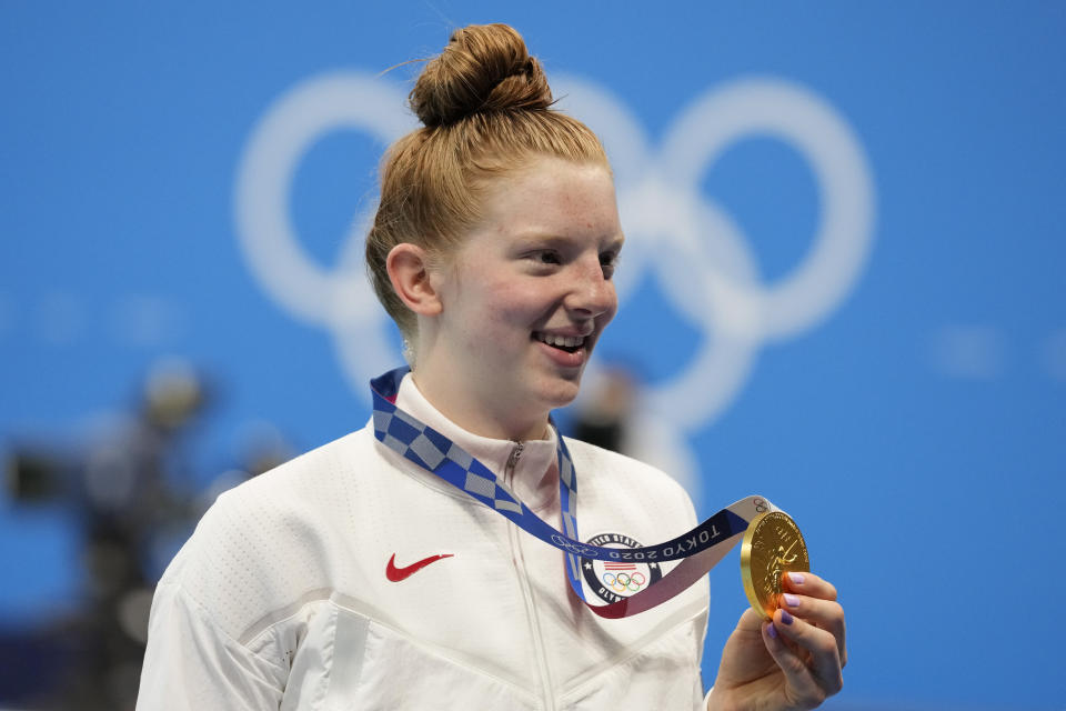 Lydia Jacoby, of the United States, poses with the gold medal after winning the final of the women's 100-meter breaststrokeat the 2020 Summer Olympics, Tuesday, July 27, 2021, in Tokyo, Japan. (AP Photo/Petr David Josek)