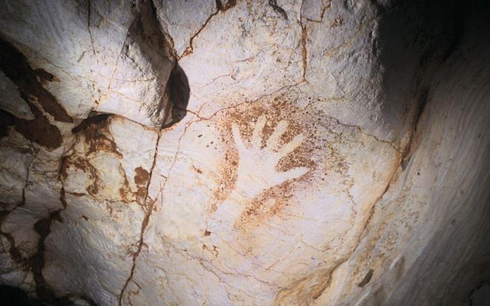 The cave has dozens of black and red hand stencils - Henri Cosquer /Gamma-Rapho