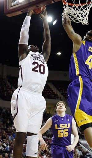 Mississippi State forward Gavin Ware (20) goes up for a dunk in front of LSU guard Corban Collins (4) during the first half of their NCAA college basketball game in Starkville, Miss., Saturday, Feb. 2, 2013. (AP Photo/Rogelio V. Solis)