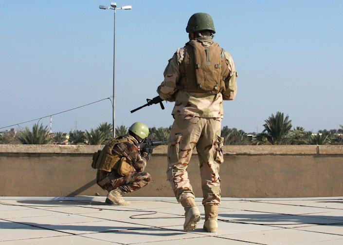 In this photo taken on Jan. 18, 2014, Iraqi army soldiers take up positions on the roof of their headquarters in Ramadi, Iraq, 70 miles (115 kilometers) west of Baghdad, Iraq. Islamic militants controlling a mainly Sunni area west of Baghdad are so well-armed that they could occupy the capital, a top Iraqi official warned Monday, a frank and bleak assessment of the challenge posed in routing the insurgents as a new wave of bombings killed at least 31 people. Since late December, members of Iraq's al-Qaida branch - known as the Islamic State of Iraq and the Levant - have taken over parts of Ramadi, the capital of the largely Sunni western province of Anbar. They also control the center of the nearby city of Fallujah, along with other non-al-Qaida militants who also oppose the Shiite-led government. (AP Photo)