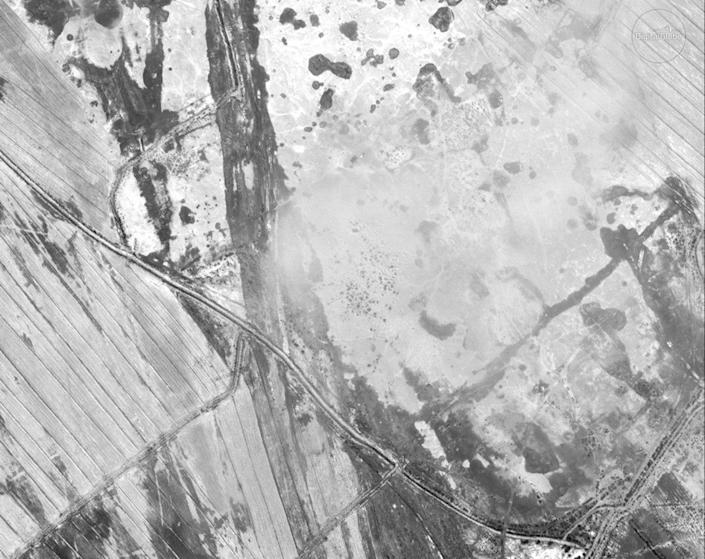 This satellite image, shot on March 10, 2018, also shows site 1056. Although looting eased off after 2009, holes left by looters can still be seen. <cite>DigitalGlobe</cite>