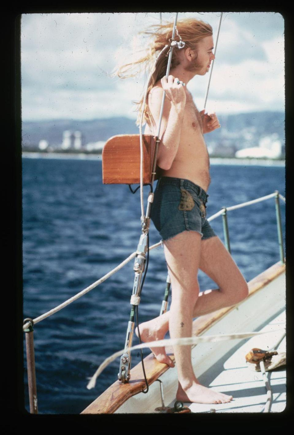 <p>A shirtless Gregg Allman leans against the ropes on a boat in 1974.</p>