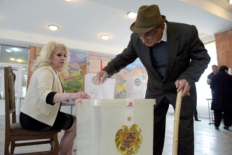 An elderly man casts his ballot at a polling station in Yerevan, the Armenian capital, in legislative elections. It is the first ballot since the adoption of constitutional reforms aimed at transforming the ex-Soviet country into a parliamentary republic