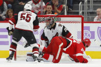 Detroit Red Wings center Michael Rasmussen (27) scores on Arizona Coyotes goaltender Darcy Kuemper (35) in the first period of an NHL hockey game Tuesday, Nov. 13, 2018, in Detroit. (AP Photo/Paul Sancya)