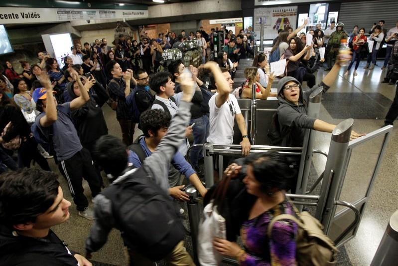 Demonstrators protest against the increase in the subway ticket prices in Santiago