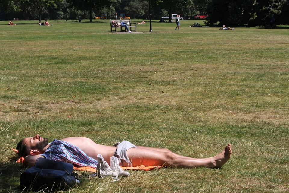 A man sunbathes in Hyde Park in London on Tuesday July 19, 2016. It was the the hottest day of 2016 in Britain, according to the Met Office. (AP Photo/Adela Suliman)