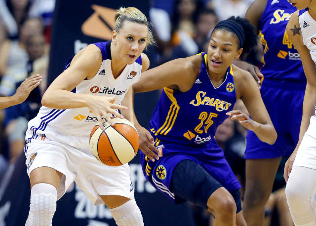 Phoenix Mercury's Penny Taylor battles Los Angeles Sparks' Marissa Coleman (25) for the ball during the first half of Game 2 of a WNBA basketball Western Conference semifinal series, Saturday, Sept. 21, 2013, in Phoenix. (AP Photo/Matt York)