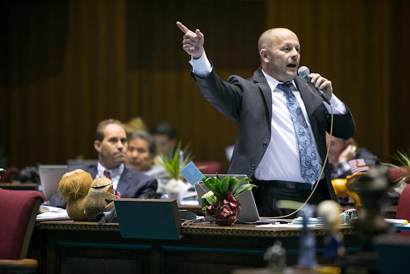 House Minority Leader Chad Campbell, (D) Phoenix, argues that House Bill 2153 would discriminate against gays and others on the House Floor in Phoenix on Thursday, Feb. 20, 2014. House Bill 2153, written by the conservative advocacty group Center for Arizona Policy and the Christian legal organization Alliance Defending Freedom, would allow individuals to use religious beliefs as a defense in a lawsuit filed by another individual. (AP Photo / The Arizona Republic, Michael Schennum)