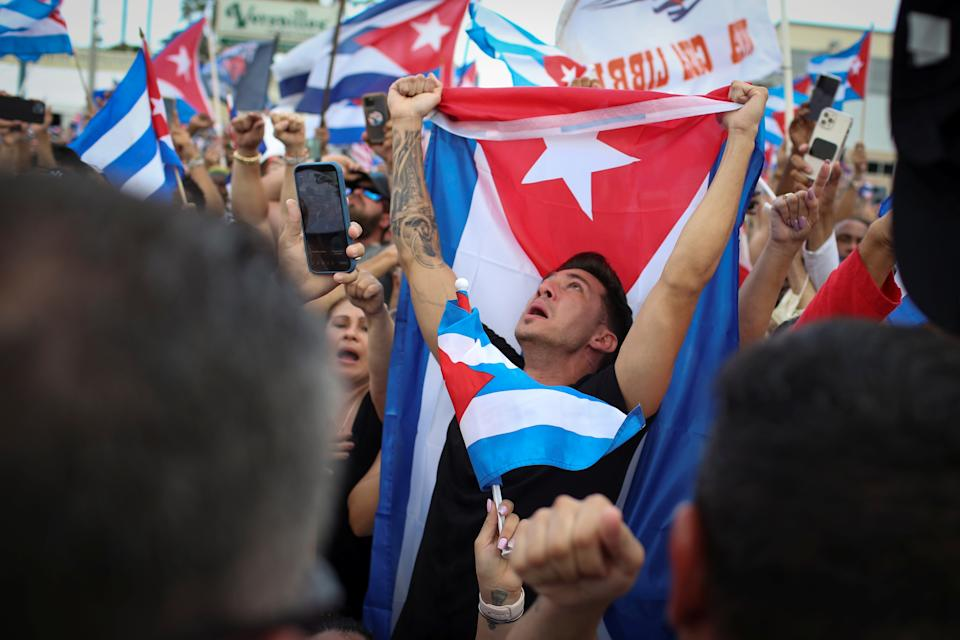 A man holds a Cuban flag during a rally in solidarity with protesters in Cuba, in Little Havana neighborhood in Miami, Florida, U.S. July 14, 2021. REUTERS/Marco Bello
