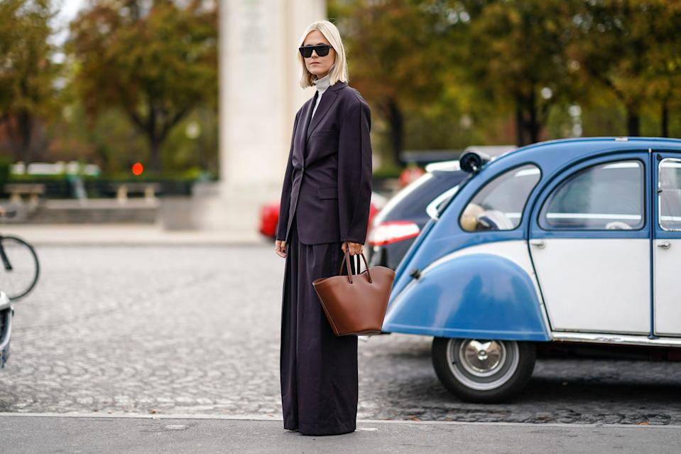 "<p class=""body-dropcap"">Micro handbags may be having a moment (and taking over Instagram), but as much as we love the trend, it barely fits our wallet, let alone our nine-to-five essentials. That said, finding a bag that's both chic <em>and</em> laptop friendly can be quite the task, especially for those who aren't into the briefcase look (no offense, Dad!). </p><p>Ahead, we have found 29 ways to make your morning commute and business travel (once these are things again), or just your trip to the couch in this new WFH normal, a thousand times easier and chicer. From leather carryalls to totes with convertible straps, shop all the best laptop bags to carry to the boardroom, brunch, and beyond. Dad would be so proud. <br></p>"