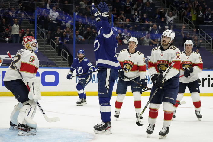 Tampa Bay Lightning left wing Alex Killorn, center, celebrates his goal against the Florida Panthers during the second period in Game 4 of an NHL hockey Stanley Cup first-round playoff series Saturday, May 22, 2021, in Tampa, Fla. (AP Photo/Chris O'Meara)