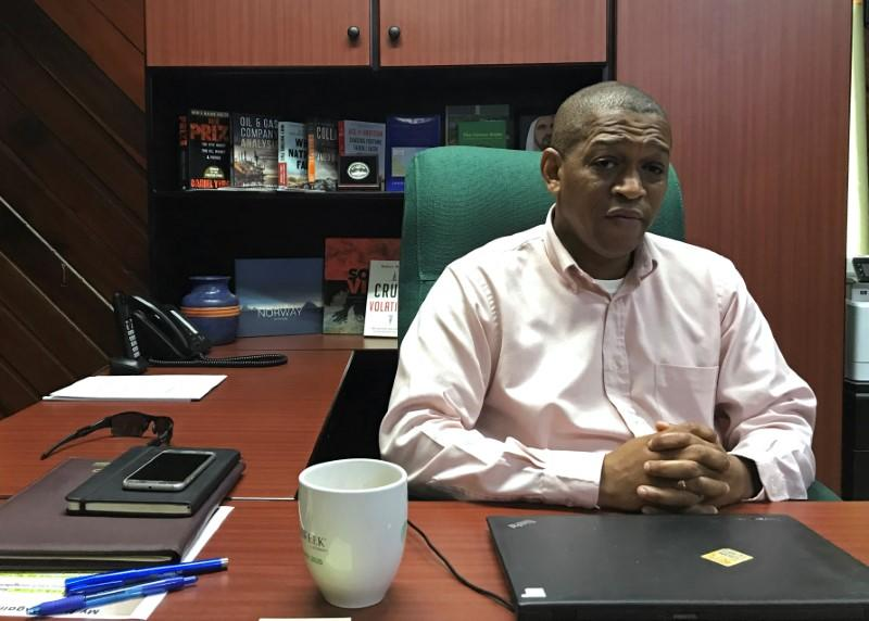 Mark Bynoe, the director of Guyana's Department of Energy, talks to Reuters in Georgetown