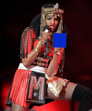 MIA performs on stage with Madonna at Super Bowl XLVI.