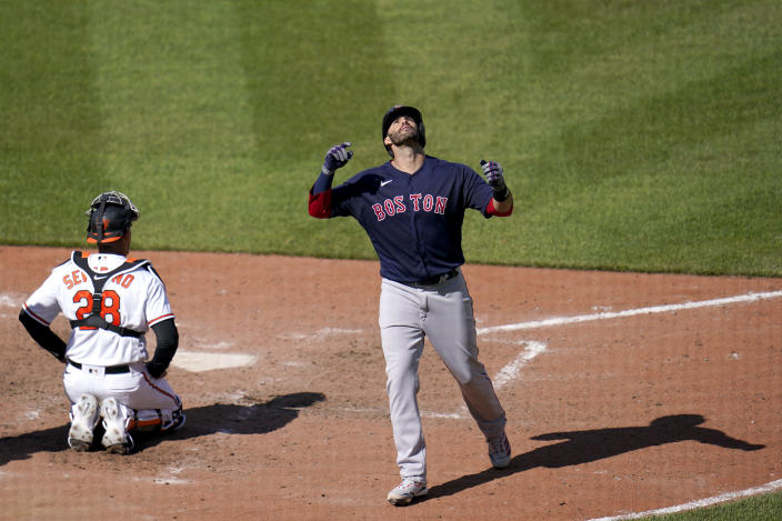 Boston Red Sox's J.D. Martinez reacts after hitting a solo home run off Baltimore Orioles starting pitcher Tyler Wells during the eighth inning of a baseball game, Sunday, April 11, 2021, in Baltimore. (AP Photo/Julio Cortez)