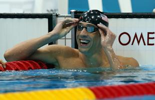 Michael Phelps celebrates winning the men's 100-meter butterfly final. (Getty Images)