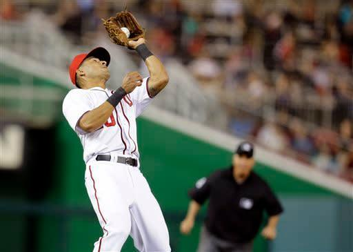 Washington Nationals shortstop Ian Desmond (20) catches the fly hit by Chicago White Sox' Jeff Keppinger, Desmond threw the ball to second for the double play out on Alejandro De Aza, during the fifth inning of an interleague baseball game at Nationals Park Tuesday, April 9, 2013, in Washington. (AP Photo/Alex Brandon)
