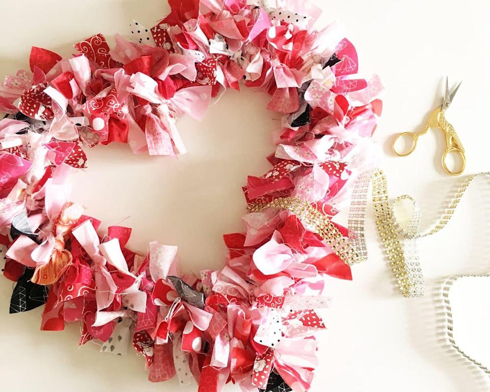 """<p>This project looks fancy — even expensive — but it's actually quite simple and kid friendly. Just pre-cut a pile of fabric scraps, and let kids tie them onto a heart wire wreath form. <em>Voila!</em></p><p><em><a href=""""https://www.polkadotchair.com/heart-fabric-rag-wreath-tutorial/"""" rel=""""nofollow noopener"""" target=""""_blank"""" data-ylk=""""slk:Get the how-to at Polka Dot Chair»"""" class=""""link rapid-noclick-resp"""">Get the how-to at Polka Dot Chair»</a></em><br></p>"""