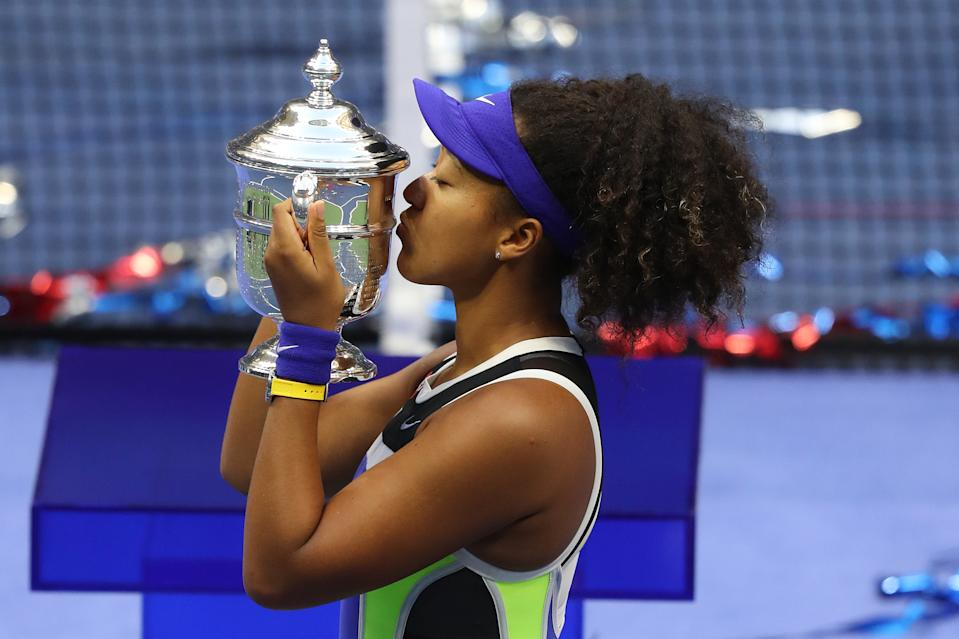 NEW YORK, NEW YORK - SEPTEMBER 12: Naomi Osaka of Japan kisses the trophy in celebration after winning her Women's Singles final match against Victoria Azarenka of Belarus on Day Thirteen of the 2020 US Open at the USTA Billie Jean King National Tennis Center on September 12, 2020 in the Queens borough of New York City. (Photo by Matthew Stockman/Getty Images)