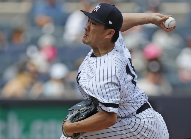 New York Yankees' starting pitcher Masahiro Tanaka winds up during the sixth inning of a baseball game against the Toronto Blue Jays, Sunday, July 14, 2019, in New York. Tanaka was the winning pitcher in the Yankees' 4-2 victory over the Toronto Blue Jays. (AP Photo/Kathy Willens)