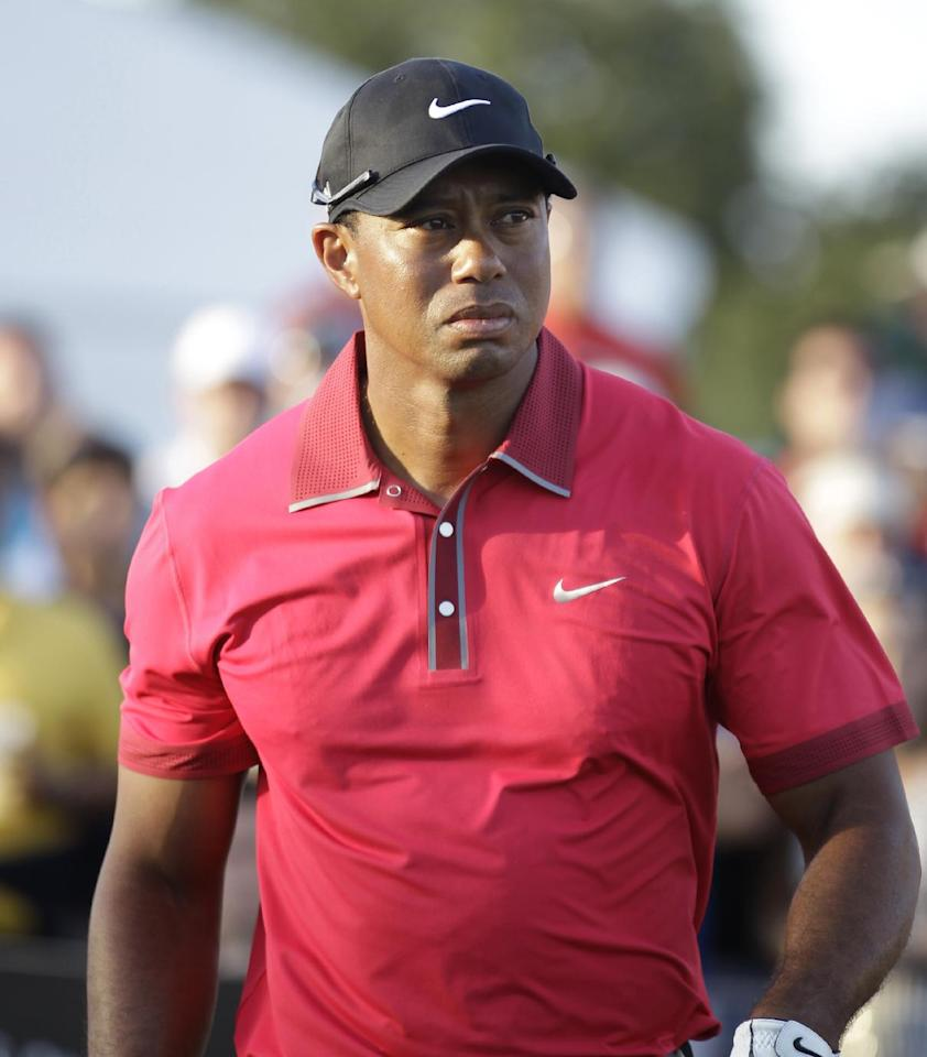 Tiger Woods leaves the 17th hole after putting during the final round of the Cadillac Championship golf tournament Sunday, March 9, 2014, in Doral, Fla. (AP Photo/Luis M. Alvarez)