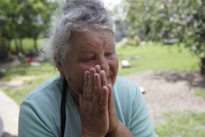 In this Wednesday, July 10, 2013 photo the mother of rape victim Irina Krashkova, 69-year-old Maria cries during an interview with the Associated Press, in the town of Vradiyevka, southern Ukraine. Corruption, lawlessness and the impunity of government officials and their wealthy friends _ be it a national lawmaker, a businessman in an expensive car or a small town cop _ have increased significantly since the 2010 election of President Viktor Yanukovych, watchdogs say. (AP Photo/Sergei Chuzavkov)
