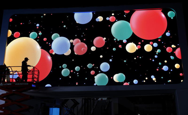 A worker helps set up the Google booth before CES International, Saturday, Jan. 4, 2020, in Las Vegas. (AP Photo/John Locher)