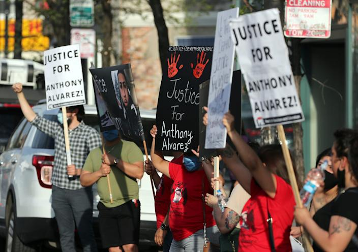 Protesters call for justice in the shooting death of Anthony Alvarez outside the headquarters of the Civilian Office of Police Accountability, Tuesday, April 27, 2021, in Chicago.