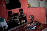"""Maria Giovanna """"Gigi"""" da Silva, who is two years old, and was born with microcephaly, sits in her home in Recife, Brazil, August 8, 2018. REUTERS/Ueslei Marcelino/Files"""